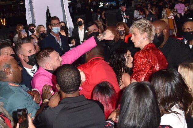Conor McGregor Tries to Fight Machine Gun Kelly on VMA Red Carpet